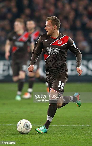 Lennart Thy of St Pauli controls the ball the ball during the Second Bundesliga match between FC St Pauli and 1 FC Union Berlin at Millerntor Stadium...