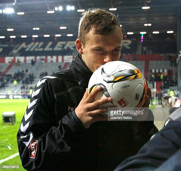 Lennart Thy of St Pauli kisses the ball during the Second Bundesliga match between FC St Pauli and Fortuna Duesseldorf at Millerntor Stadium on...