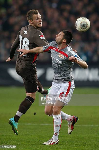 Lennart Thy of StPauli and Marc Pfertzel of Berlin compete for the ball during the Second Bundesliga match between FC St Pauli and 1 FC Union Berlin...