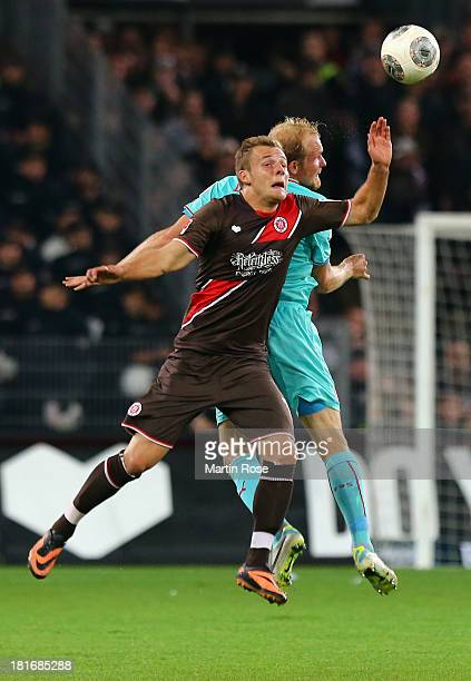 Lennart Thy of StPauli and Tobias Levels of Duesseldorf jump to head for the ball during the Second Bundesliga match between FC St Pauli and Fortuna...