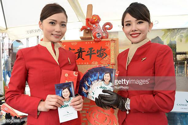 Lenni and Kylie members of the Cathey Pacicif airline staff show the company promotional leaflets as one of the biggest airline in the world Hong...