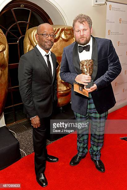 Lennie James and George Steel winner of the Photography Lighting Fiction award for 'Peaky Blinders' pose in the press room at the BAFTA Television...