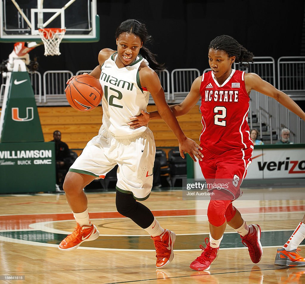 Len'Nique Brown #2 of the North Carolina State Wolfpack defends against Krystal Saunders #12 of the Miami Hurricanes as she dribbles the ball on December 20, 2012 at the BankUnited Center in Coral Gables, Florida. The Hurricanes defeated the Wolfpack 79-53.