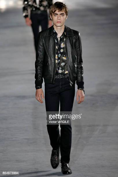 Lennon Gallagher walks the runway during the Saint Laurent Ready to Wear Spring/Summer 2018 fashion show as part of the Paris Fashion Week Womenswear...