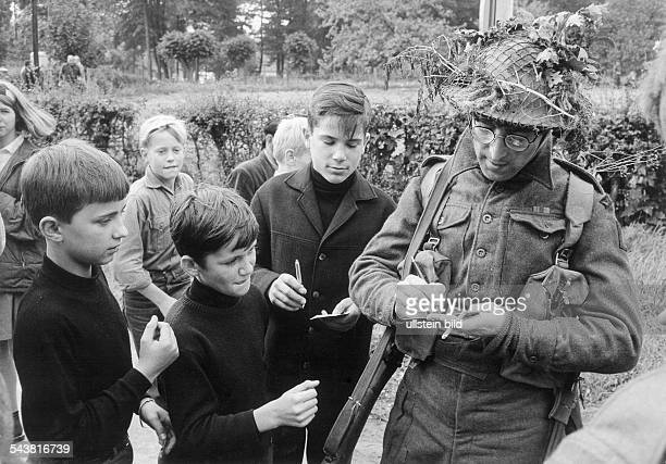 Lennon John Musician GB together with fans in the Lueneburger Heide Northern Germany shooting of 'How I won the War' 1966