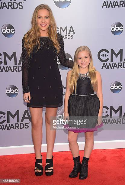 Lennon Stella and Maisy Stella attend the 48th annual CMA Awards at the Bridgestone Arena on November 5 2014 in Nashville Tennessee