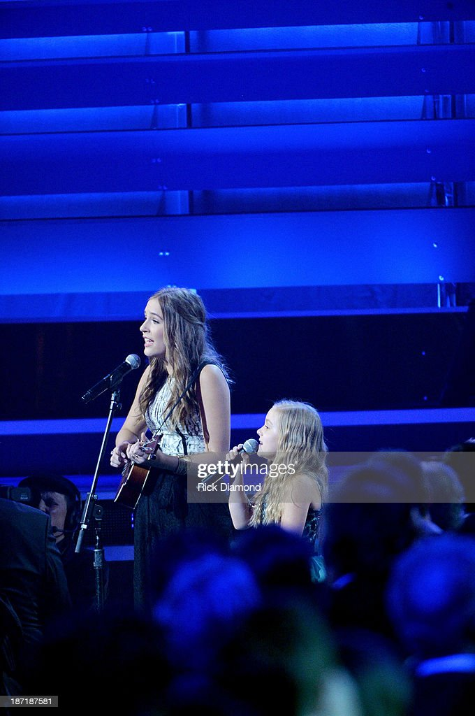 Lennon Stella and Maisy Stella perform onstage during the 47th annual CMA Awards at the Bridgestone Arena on November 6, 2013 in Nashville, Tennessee.