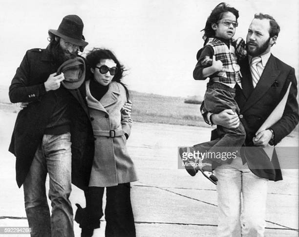 Lennon's beard has been partly shaved away to allow a nasty gash to be stitched hence he is holding her hat at his chin and Yoko has a plaster on her...