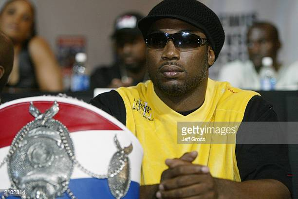 Lennox Lewis sits with one of his heavy weight world championship belts during press conference to promote his upcoming fight with Vitali Klitschko...