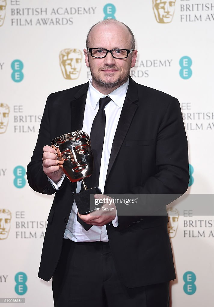 <a gi-track='captionPersonalityLinkClicked' href=/galleries/search?phrase=Lenny+Abrahamson&family=editorial&specificpeople=4598043 ng-click='$event.stopPropagation()'>Lenny Abrahamson</a>, accepting the Best Actress award on behalf of Brie Larson for 'Room' poses in the winners room at the EE British Academy Film Awards at the Royal Opera House on February 14, 2016 in London, England.