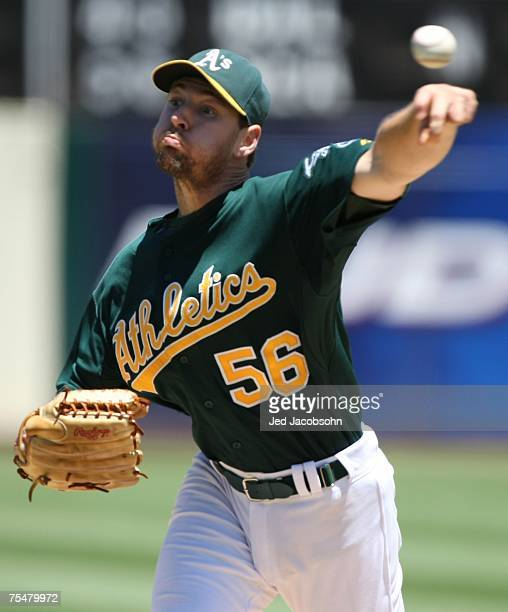 Lenny DiNardo of the Oakland Athletics pitches against the Texas Rangers during a Major League Baseball game on July 18 2007 at McAfee Coliseum in...