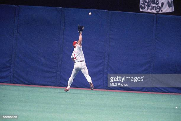 Lenny Dykstra of the Philadelphia Phillies leaps to make the catch during game six of the 1993 World Series against the Toronto Blue Jays at the...