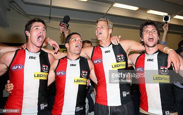 Lenny Hayes Leigh Montagna Nick Riewoldt and Farren Ray of the Saints sing the song in the rooms after winning the round two AFL match between the St...