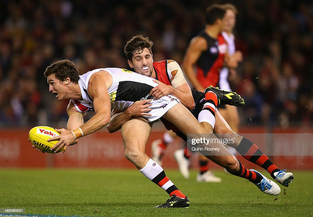 <a gi-track='captionPersonalityLinkClicked' href=/galleries/search?phrase=Lenny+Hayes&family=editorial&specificpeople=208719 ng-click='$event.stopPropagation()'>Lenny Hayes</a> of the Saints is tackled by David Myers of the Bombers during the round five AFL match between the Essendon Bombers and the St Kilda Saints at Etihad Stadium on April 19, 2014 in Melbourne, Australia.