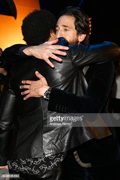 Lenny Kravitz and Adrien Brody are seen backstage at the GQ Men Of The Year Award 2014 at Komische Oper on November 6 2014 in Berlin Germany
