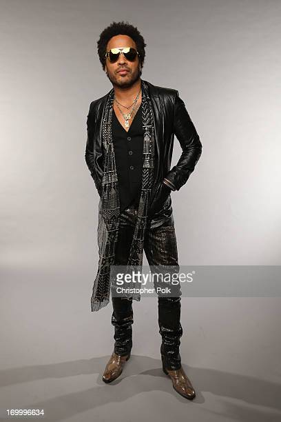 Lenny Kravitz poses at the Wonderwall portrait studio during the 2013 CMT Music Awards at Bridgestone Arena on June 5 2013 in Nashville Tennessee