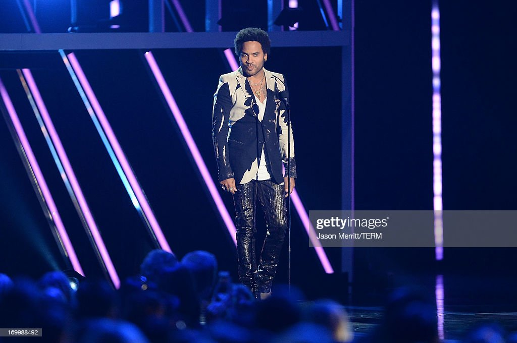 <a gi-track='captionPersonalityLinkClicked' href=/galleries/search?phrase=Lenny+Kravitz&family=editorial&specificpeople=171613 ng-click='$event.stopPropagation()'>Lenny Kravitz</a> speaks onstage during the 2013 CMT Music awards at the Bridgestone Arena on June 5, 2013 in Nashville, Tennessee.