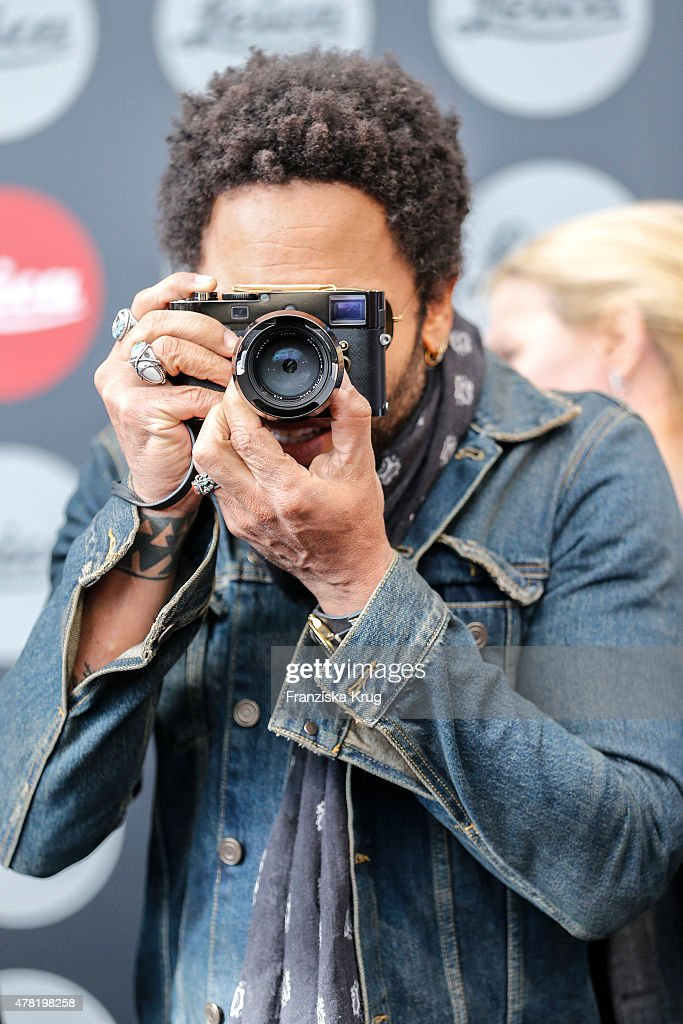 Lenny Kravitz takes a picture during the vernissage 'Flash by Lenny Kravitz' on June 23, 2015 in Wetzlar, Germany.