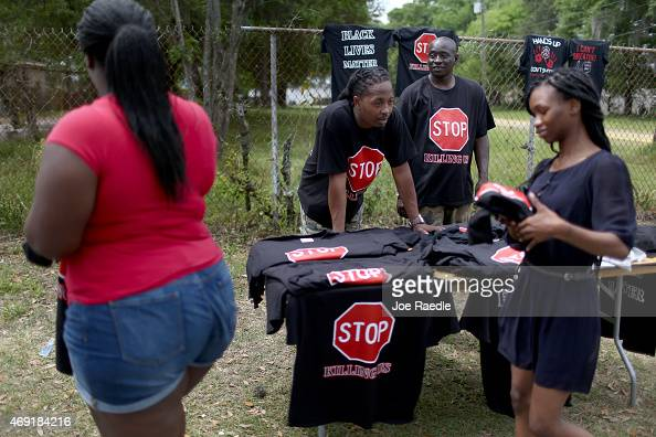 Lenny Williams and James Johson sell teeshirtsh reading 'Stop Killing Us' near the spot where Walter Scott was killed on April 4th by a North...
