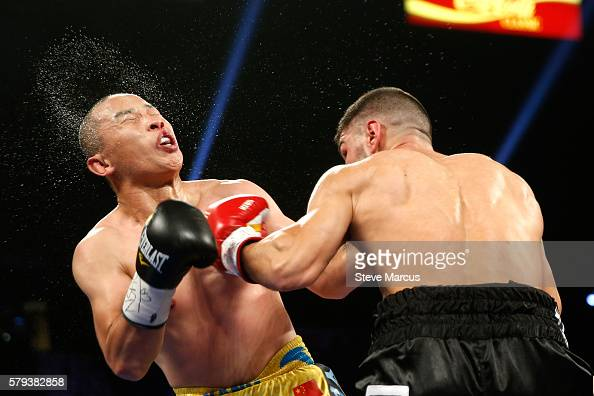 Lenny Zappavigna of Australia lands a punch on Lianhui Yang of China during a superlightweight bout at MGM Grand Garden Arena on July 23 2016 in Las...