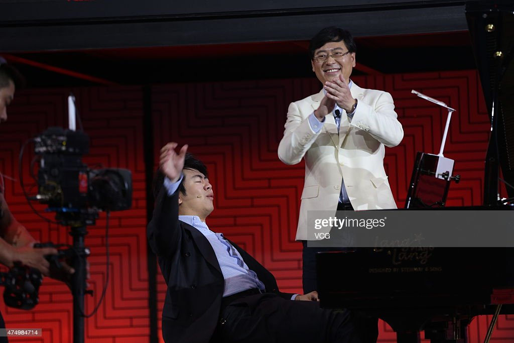 Lenovo Chairman and CEO Yang Yuanqing and pianist Lang Lang perform during the Lenovo Tech World at China National Convention Center on May 28 2015...