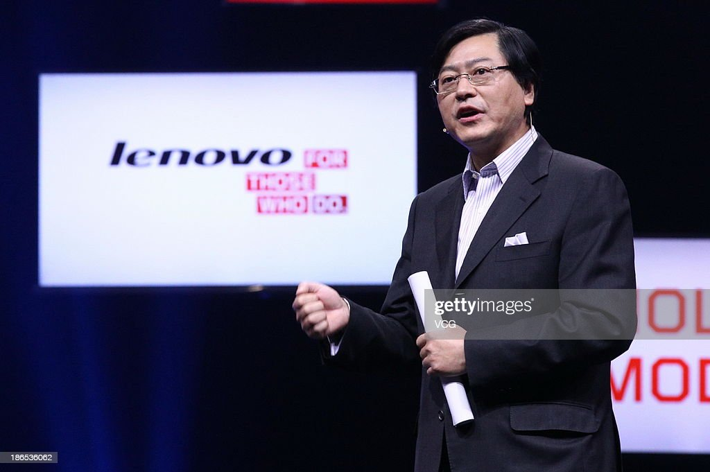 Lenovo Chief Executive Officer <a gi-track='captionPersonalityLinkClicked' href=/galleries/search?phrase=Yang+Yuanqing&family=editorial&specificpeople=2195940 ng-click='$event.stopPropagation()'>Yang Yuanqing</a> attends the launching ceremony of Yoga Tablet at China National Convention Center on November 1, 2013 in Beijing, China. The world's largest personal computer maker Lenovo launched its high-end product Yoga today.