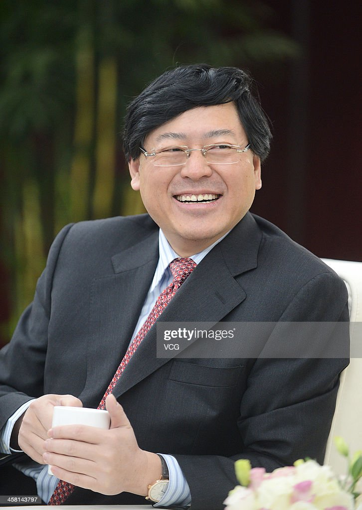 Lenovo Chief Executive Officer <a gi-track='captionPersonalityLinkClicked' href=/galleries/search?phrase=Yang+Yuanqing&family=editorial&specificpeople=2195940 ng-click='$event.stopPropagation()'>Yang Yuanqing</a> reacts during the Lenovo MIDH (Mobile Internet and Digital Home) Wuhan Operation Center grand opening ceremony on December 19, 2013 in Wuhan, China. The plant will mainly produce Lenovo smart phones and tablet computers with an initial capacity of 30 million units a year.