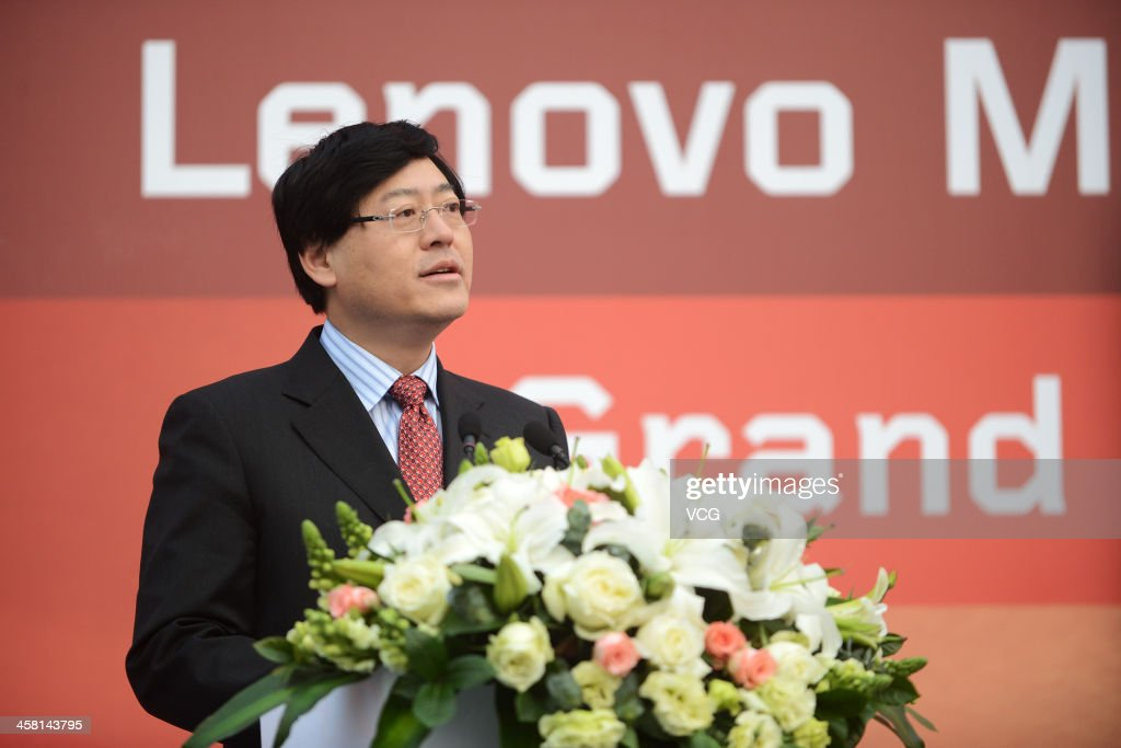 Lenovo Chief Executive Officer <a gi-track='captionPersonalityLinkClicked' href=/galleries/search?phrase=Yang+Yuanqing&family=editorial&specificpeople=2195940 ng-click='$event.stopPropagation()'>Yang Yuanqing</a> speaks during the Lenovo MIDH (Mobile Internet and Digital Home) Wuhan Operation Center grand opening ceremony on December 19, 2013 in Wuhan, China. The plant will mainly produce Lenovo smart phones and tablet computers with an initial capacity of 30 million units a year.