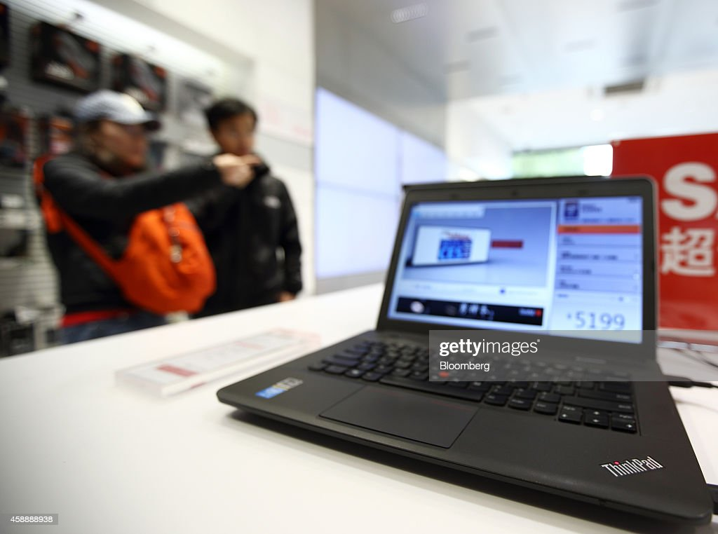 A Lenovo Group Ltd computer sits on display at the company's flagship store on Qianmen Street in Beijing China on Tuesday Nov 11 2014 Lenovo Chief...