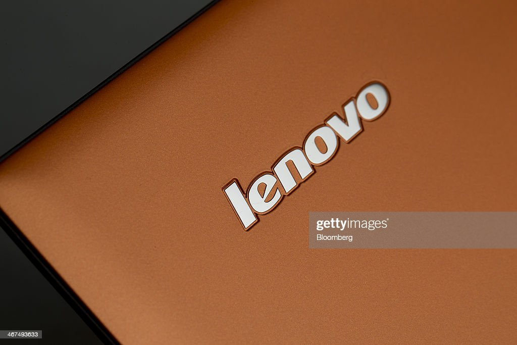 A Lenovo Group Ltd. logo is displayed on a IdeaPad Yogo 2 Pro as it sits on display in this arranged photograph at a Lenovo store in the Sha Tin district of Hong Kong, China, on Friday, Feb. 7, 2014. Lenovo, which has headquarters in Beijing and Morrisville, North Carolina, agreed to pay $2.3 billion for IBMs low-end server unit on Jan. 23, adding a business with wider profit margins than PCs and giving it about 14 percent of the market. Photographer: Brent Lewin/Bloomberg via Getty Images