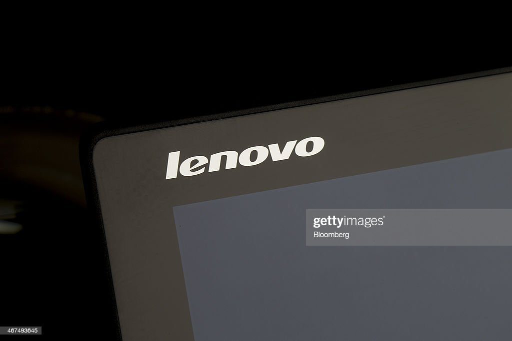 A Lenovo Group Ltd. logo is displayed on a ThinkPad T440s as it sits on display in this arranged photograph at a Lenovo store in the Sha Tin district of Hong Kong, China, on Friday, Feb. 7, 2014. Lenovo, which has headquarters in Beijing and Morrisville, North Carolina, agreed to pay $2.3 billion for IBMs low-end server unit on Jan. 23, adding a business with wider profit margins than PCs and giving it about 14 percent of the market. Photographer: Brent Lewin/Bloomberg via Getty Images