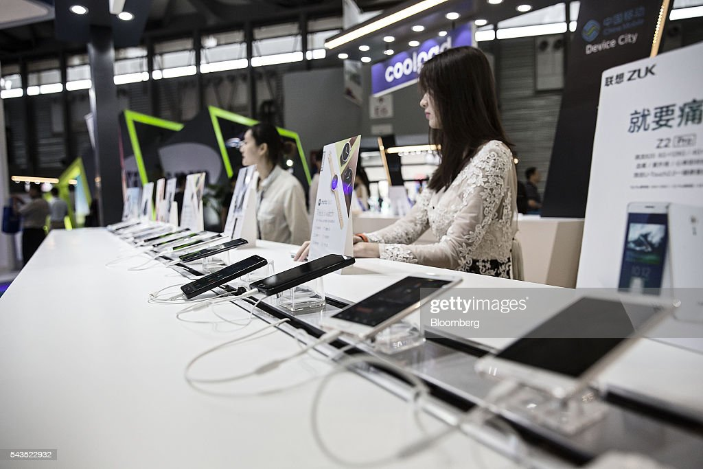 Lenovo Group Ltd smartphones are displayed at the company's booth at the Mobile World Congress Shanghai in Shanghai China on Wednesday June 29 2016...