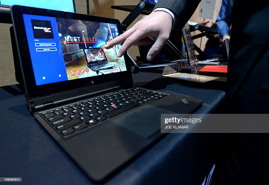 Lenovo introduces their new tablet/laptop Thinkpad Helix during the opening event ''CES Unveiled'' during the International Consumer Electronics Show (CES) in Mandalay Bay Hotel resort on January 06, 2013 in Las Vegas, Nevada.AFP PHOTO / JOE KLAMAR