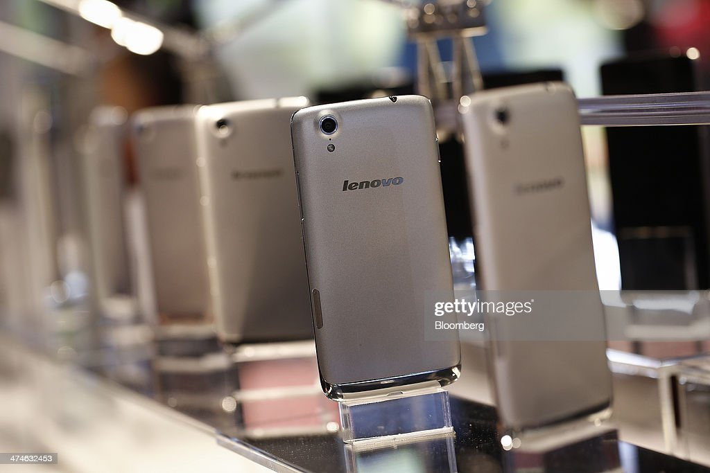 Lenovo Vibe X smartphones sit on display at Lenovo Group Ltd pavilion on the opening day of the Mobile World Congress in Barcelona Spain on Monday...