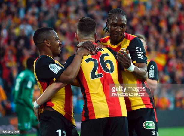 Lens Christian Lopez Santamaria celebrates with teammates after scoring a goal during the French L2 football match between Lens and Niort on May 19...