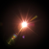 Lens flare on black background. Design Element. Stock photo.