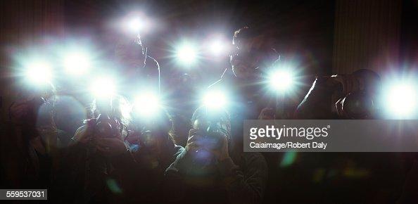 Lens flash of paparazzi photographers cameras