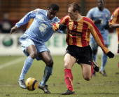 Ajaccio's forward Kaba Diawara vies with Lens's defender Nicolas Gillet during their French L1 football match 26 February 2006 at the Felix Bollaert...