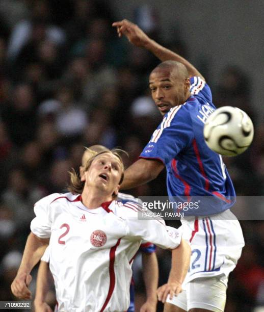 French player forwartd Thierry Henry vies with Danish midfielder Christian Poulsen during the friendly football match France vs Denmark at the...
