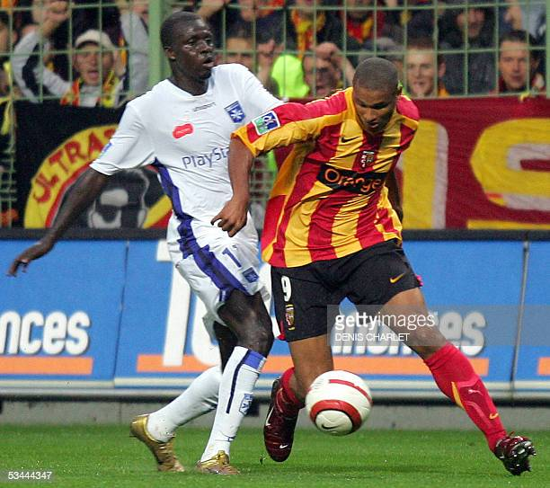 Len's defender Daniel Cousin vies with Auxerre's forward Akale Kanga during their French L1 football match 20 August 2005 at the Felix Bollaert...