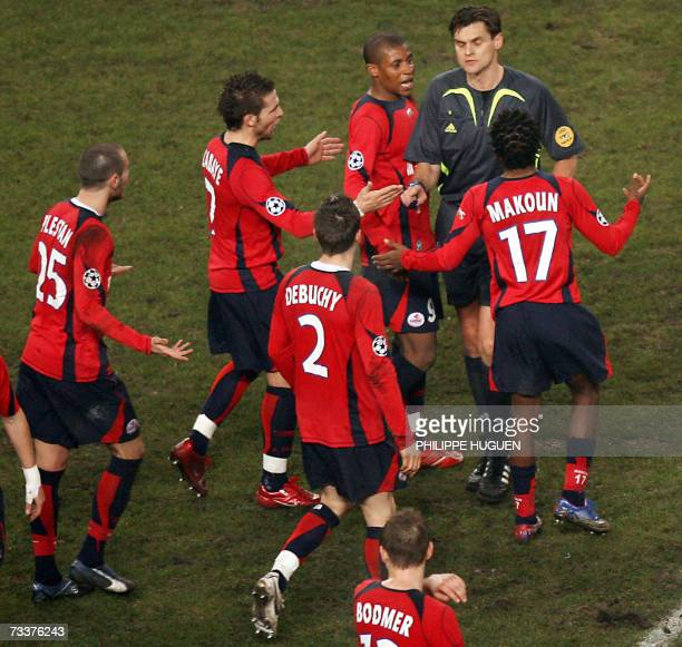 Lille players speak with referee Franck De Bleeckere after Manchester's goal during the Champions League football match Lille vs Manchester United at...