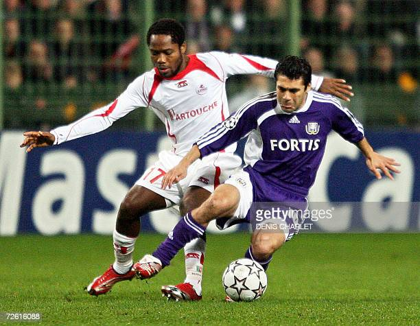Lille's Cameroonian midfielder Jean II Makoun vies with Anderlecht's midfield Hassan Ahmed during the Champion's league football match Lille vs...