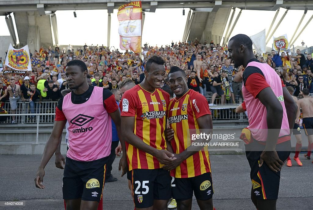 Lens' French defender Loic Landre (2nd R), Lens' French defender Jean Philippe Gbamin (2nd L) after winning the French L1 football match between Lyon (OL) and Lens (RCL) at the Gerland stadium in Lyon, central-eastern France, on August 24, 2014. AFP PHOTO / ROMAIN LAFABREGUE