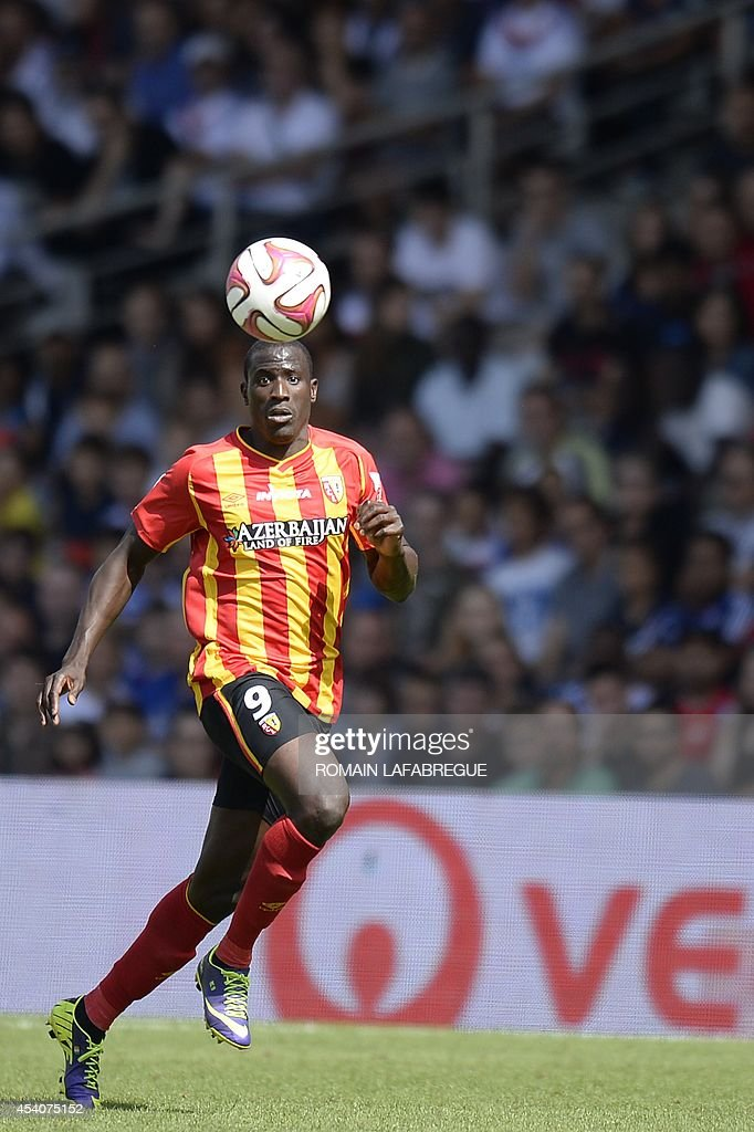 Lens' French forward Adamo Coulibaly looks at the ball as he runs during the French L1 football match between Lyon (OL) and Lens (RCL) at the Gerland stadium in Lyon, central-eastern France, on August 24, 2014. AFP PHOTO / ROMAIN LAFABREGUE