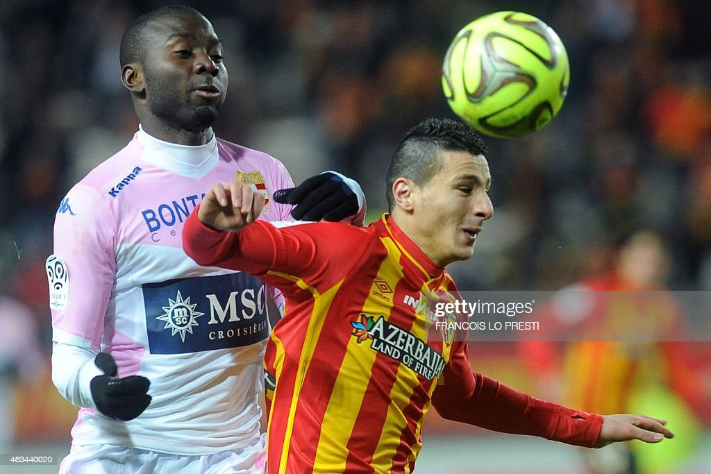 Lens' French forward Yoann Touzghar (R) vies with Evian's French <a gi-track='captionPersonalityLinkClicked' href=/galleries/search?phrase=Cedric+Mongongu&family=editorial&specificpeople=4305033 ng-click='$event.stopPropagation()'>Cedric Mongongu</a> during the French L1 football match between Lens and Evian Thonon on February 14, 2015 at the Licorne stadium in Amiens, northern France. AFP PHOTO / FRANCOIS LO PRESTI