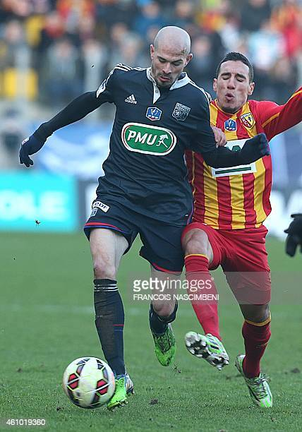 Lens' French midfielder Alharbi El Jadeyaoui vies with Lyon's midfielder Christophe Jallet during the French Cup round of 64 football match betweenn...