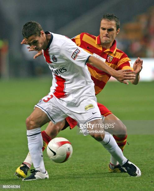 Lens' French midfielder Olivier Monterrubio vies with PSG' French midfielder Jeremy Clement during the French L1 football match Lens vs PSG 12 August...