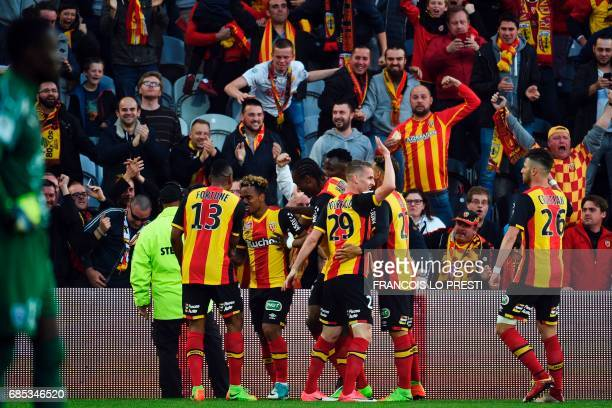Lens Kermit Romeo Erasmus celebrates with teammates after scoring a goal during the French L2 football match between Lens and Niort on May 19 2017 at...