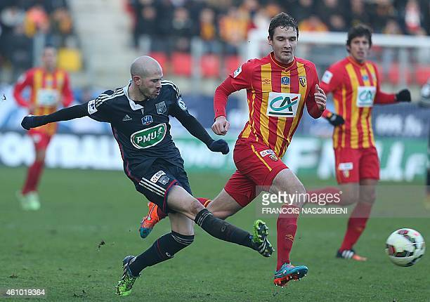 Lens' midfielder Benjmin Boulenger vies with Lyon's defender Christophe Jallet during the French Cup round of 64 football match betweenn Lens and...
