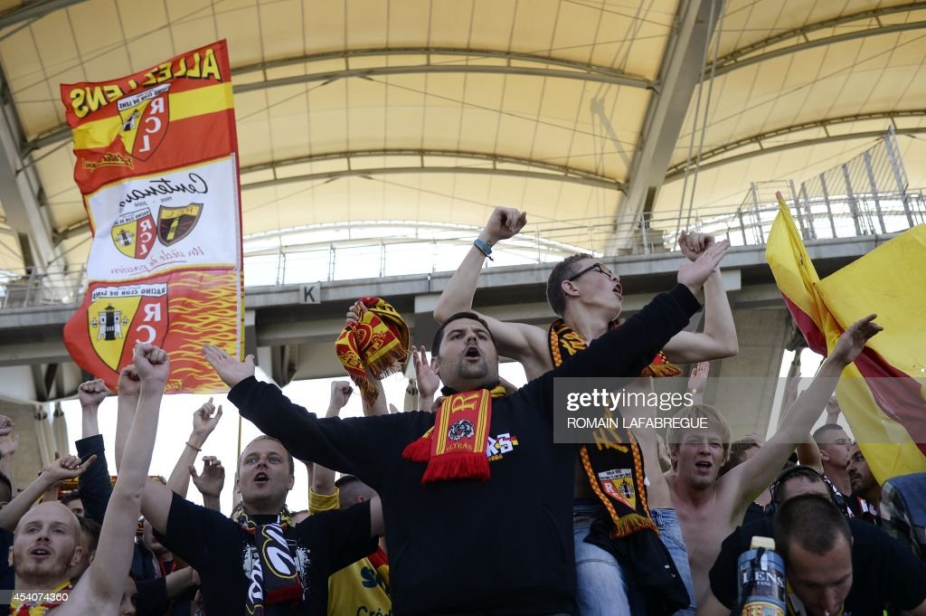 Lens' supporters cheers during the French L1 football match between Lyon (OL) and Lens (RCL) at the Gerland stadium in Lyon, central-eastern France, on August 24, 2014. AFP PHOTO / ROMAIN LAFABREGUE